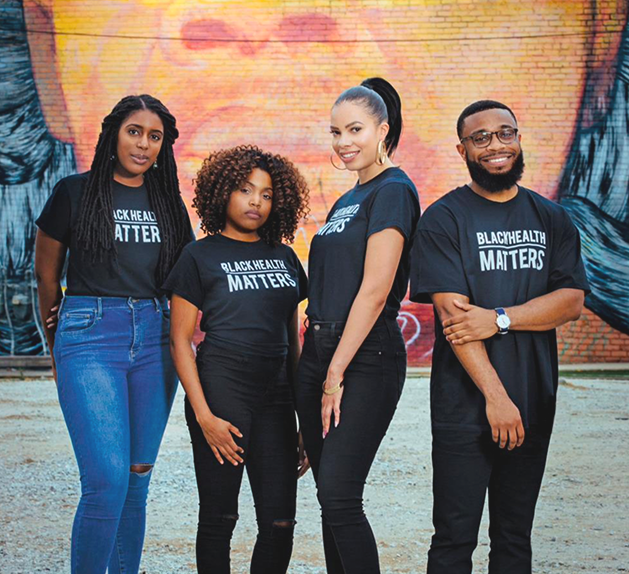 4 individuals standing in front of a mural with Black Health Matters shirts